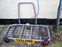 car trailer for mobilty scotter goes on back of a car. can also carry other items,