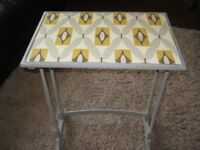 shabby chic side table in grey with retro style paper on top