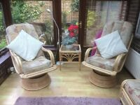Two quality cane swivel and rocking chairs in excellent condition with matching cushions.