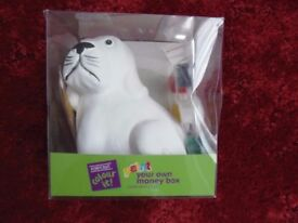 Paint your own money box dog. Complete in box, never opened £2