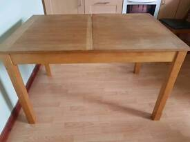 Extendable wood table sits 4 or 6