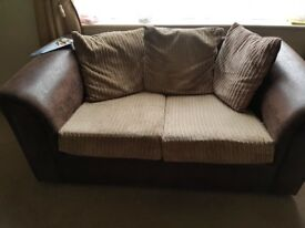 Brown leather faux 3 and 2 settees no rips or tears nice condition