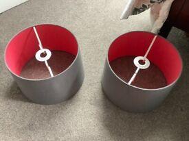 A pair of grey lampshades
