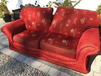2 red fabric 2 seater sofas