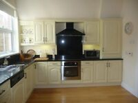 Cream Kitchen Units with Polished Granite worktops, Neff cooker hood, Belling Oven and Dresser