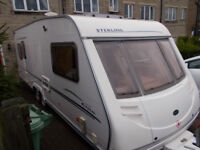 STERLING ELITE WAYFARER 5 BERTH TWIN AXLE CARAVAN WITH FULL ISABELLA AWNING