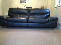 3 seater black leather sofa from Sterling Furniture.