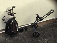 Set of Ping Zing irons with carry bag and Powakaddy Twinline 1 push trolley