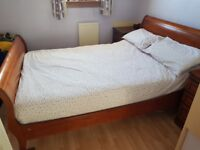 Double sleigh bed and 2 bedside cabinets