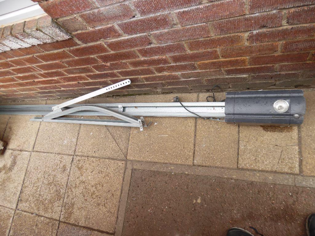 Electric garage door opener with remote 100 in for Motorized garage door opener