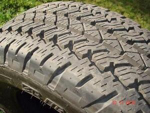 4 - Bridgestone Dueler tires P265/70R/17 A/T  RH-S  (M+S) , standard load