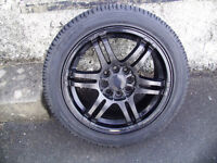 15inch Black alloy wheels.