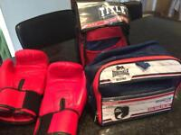 Boxing gloves, head-guard and pads