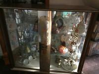 Glass and wood ornament display cabinet