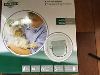 New in box PetSafe cat flap for small dog or large cat.