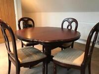 Extendable mahogany dining table.