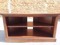 Wooden Television Stand with space for media below.