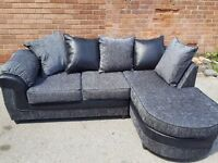 Fabulous Brand New corner sofa.black and grey fabric with chase lounge.delivery available