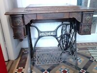 Sewing machine by Singer and table.