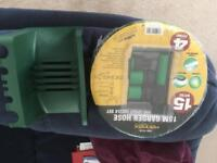 15 m Garden hose and wall holder