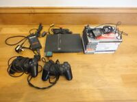 Playstation 2 Slimline including card, 2 controls, games shown