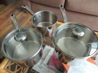 Set of thrdee stainless steel cooking pots