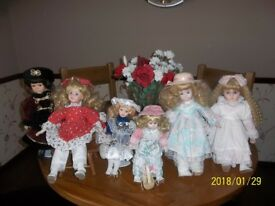 six china dolls plus a wicker dolls pram plus doll