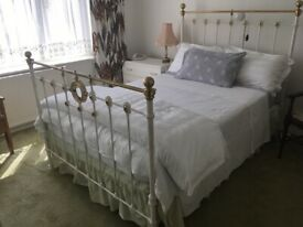 Cast iron and brass double bed and mattress