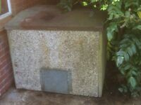 Concrete coal bunker with steel lid
