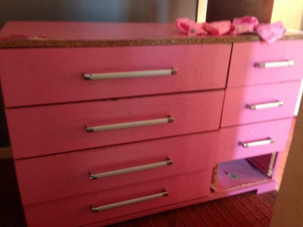 Pink chest of drawers.