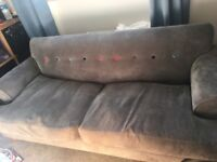 Grey Sofa with coloured buttons