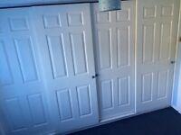 White panel wardrobe sliding doors and track
