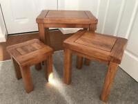 Solid original rustic oak nest of three tables