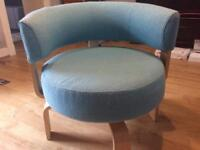 Round heavily cushioned swivel chair
