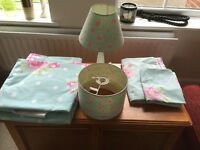 Matching Rosebud duvet cover, pillow case, curtains, lamp shade and bedside light from Next