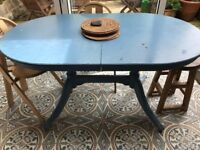 Solid wood. Well used and loved Blue dining table extending 6-8 persons