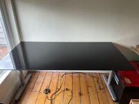 Black, glass-top desk / table