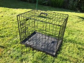 Black dog crate good condition.