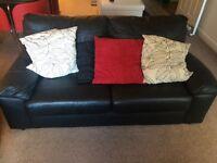 two gorgeous 2 seater black leather sofas