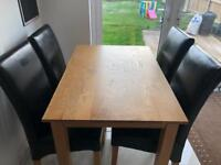 Oak dining table & 4 nearly new leather chairs