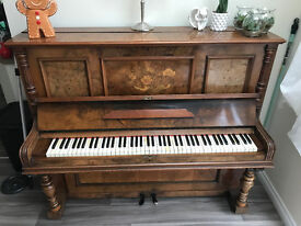 A Langer Berlin Upright Piano
