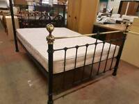 Black metal bed frame with double mattress