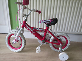 """Great little girls bike..""""huffy poppie"""".12"""" wheels. good condition,ready to ride away."""
