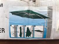 Wall mounted garden parasol