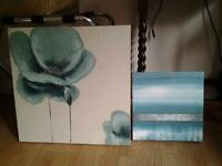 2 turquoise canvas prints.