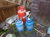 Gas bottles for sale one large and 2 small think they are empty wood stove
