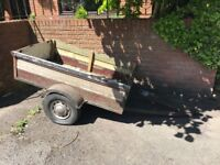 Solid hand made trailer. Hitch needs replacing but otherwise solid!