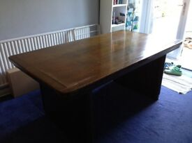 Large solid dark wood dining table