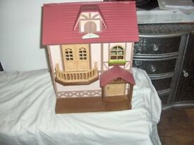 sylvanians lakeside lodge with some accessories as photos