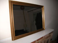 "Antique gold framed wall mirror 33"" wide by 23"" high"